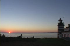 The West Quoddy Head Lighthouse adorns the coastline at golden-hour. Stock Footage
