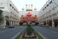 Neon signs mark the entrance to Taj Mahal Casino in Atlantic City. Stock Footage