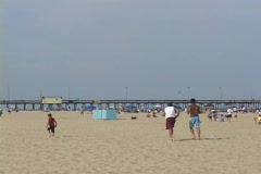 Medium shot of a summer beach scene at Atlantic City, New Jersey with amusement Stock Footage