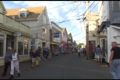 Medium shot of tourists walking on a street in Nantucket, Cape Cod. Stock Footage