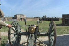 A man fires a cannon at a historic fort. Stock Footage