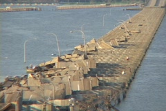 People work on a destroyed causeway along the Gulf Coast of Mississippi, Stock Footage