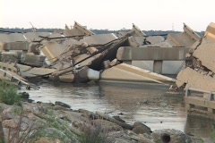 Water flows around a destroyed causeway along the Gulf Coast of Mississippi Stock Footage
