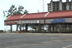 A heavily damaged strip mall stands in the wake of Hurricane Katrina. Stock Footage