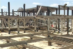 A building frame remains after Hurricane Katrina. Stock Footage