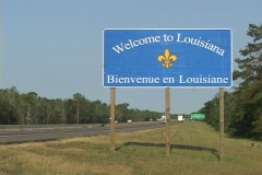 A highway sign greets visitors to Louisiana. - stock footage