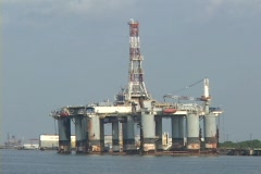 People repair an oil platform along the Gulf Coast following Hurricane Katrina. Stock Footage