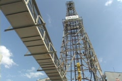 An oil derrick stands in the sun. Stock Footage