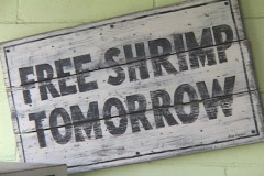 A sign reads Free Shrimp Tomorrow. Stock Footage