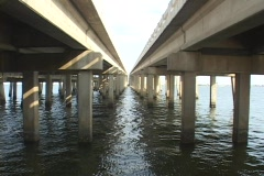 Water moves under two bridges. Stock Footage
