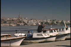 Fishing boats float at the docks at the Golden Horn in Istanbul, Turkey. Stock Footage