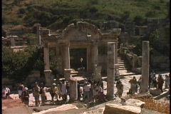 Tourists visit the Temple of Hadrian in Ephesus, Turkey. Stock Footage