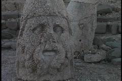 The broken head of Antiochus lies at Mount Nemrut in Turkey. Stock Footage