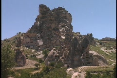 Stock Video Footage of Fairy-chimney rock formations adorn a hill at Cappadocia, Turkey.