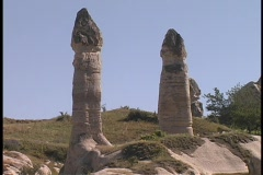 Fairy-chimney rock formations adorn the hills in Cappadocia, Turkey. Stock Footage