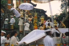 A religious procession walks to a temple in Bali. Stock Footage