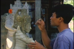 A man skillfully carves a statue. Stock Footage