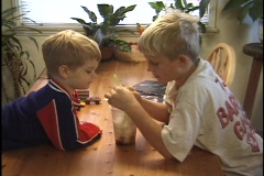 Young boys share a milkshake. Stock Footage
