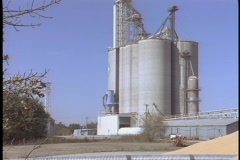 A granary sits next to a huge pyramid of wheat. Stock Footage