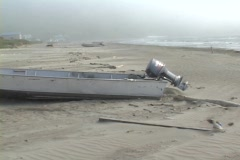 A motorboat lies deserted on a shore in a remote village in the Aleutian Stock Footage