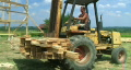 Forklift Unloading Construction Lumber HD Footage