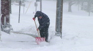 Stock Video Footage of Man Shoveling Snow 02