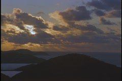 Stock Video Footage of Clouds drift over a chain of Caribbean islands.