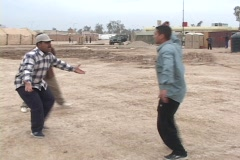 An Iraqi man attacks another man with a knife at a school for Iraqi police. Stock Footage