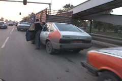 Iraqis push their cars while they wait for gas in Baghdad. Stock Footage