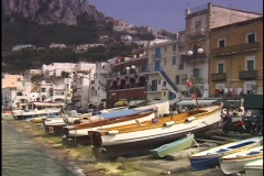 Fishing boats line the shore in the Isle of Capri. Stock Footage