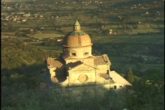 A large church dominates the Italian countryside. - stock footage