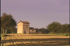An Italian farmhouse sits next to fields. Stock Footage