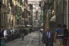 Pedestrians walk down a narrow street in Florence. Stock Footage