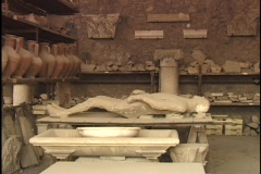 A Pompeii mummy lies in an archaeological dig workshop. Stock Footage