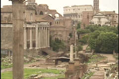 The ancient Coliseum towers over other Roman ruins. Stock Footage