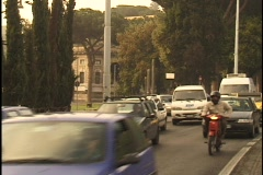 Traffic travels down a street in Rome. Stock Footage