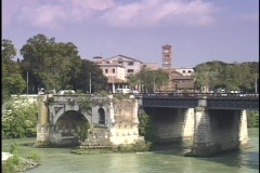 Traffic crosses a bridge over the Tiber River. Stock Footage