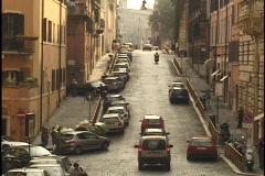 Traffic travels down a narrow street in Rome. Stock Footage