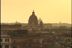 A stone cathedral rises above the skyline of Rome, Italy. Stock Footage