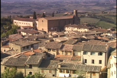 The hills of Tuscany surround the walled village of San Gimignano. Stock Footage