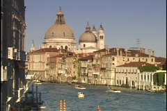 The cathedrals of the Santa Maria del Salute tower over the Grand Canal in Stock Footage