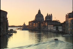 A small boat motors through the Grand Canal, passing in front of the Santa Maria Stock Footage