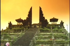 A monk climbs a long staircase to a temple. Stock Footage