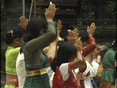 Stock Video Footage of A group of girls stand together in prayer with their hands clasped above their
