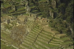 The ruins of Machu Picchu rest against in a steep mountain hillside in Peru. Stock Footage
