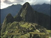 Stock Video Footage of The ancient ruins of Machu Picchu lie in the mountain hillsides of Peru.