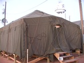 Stock Video Footage of Medium shot of a FEMA refugee tent.