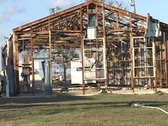 Stock Video Footage of Medium shot of the frame of a house stripped bare by Hurricane Katrina.