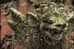 A Balinese stone carving of a Hindu image adorns a wall in Bali, Indonesia. Stock Footage