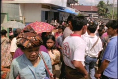 Stock Video Footage of Patrons crowd a market in Indonesia.